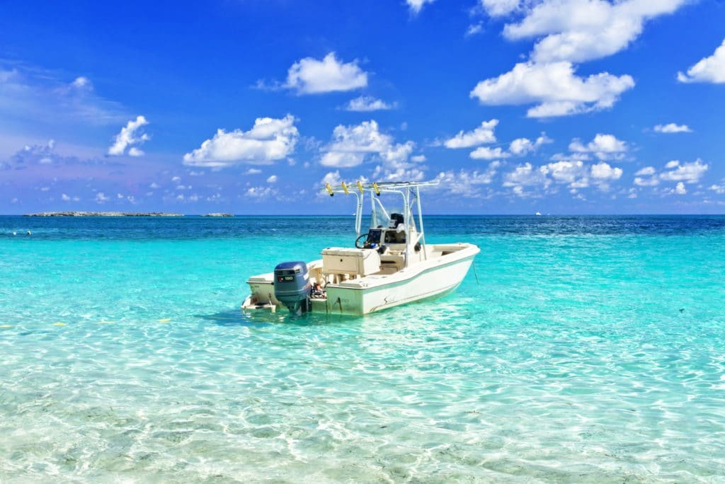 White boat on turquoise water.