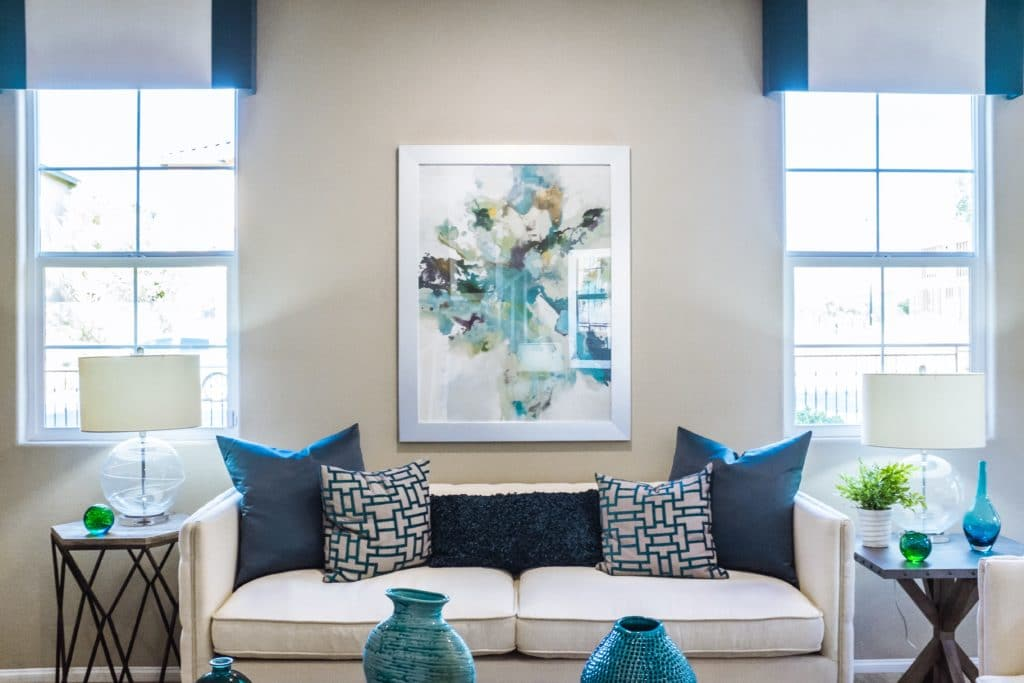A family room furnished in white and blue tones.